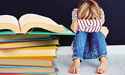 Image from the cover of Failing Students or Failing Schools by Faith Borkowsky showing a child in despair next to a very large stack of books.